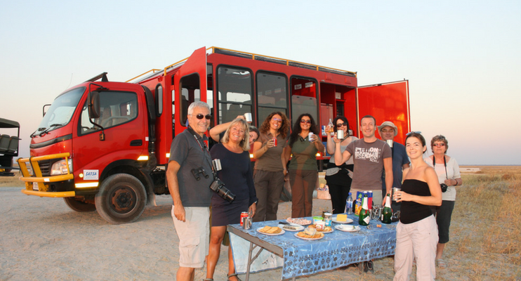 indafrica-sunway-safaris-nambia-botswana-overland-camping-red-truck-food-eating