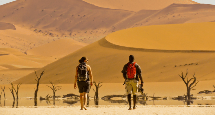 WVac15-sunway-safari-desert-Namibia-people-explore-barefoot-camel-thorn-tree-expanse-breathtaking